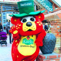 Karlchen the official mascot greets everybody on the way in - HiVino