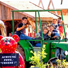 enjoying a tractor ride at Karls Erlebnishof, Germany - HiVino